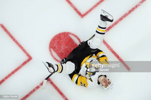 Evgeni Malkin of the Pittsburgh Penguins stretches during warm-ups prior to the game against the New York Islanders at NYCB Live at the Nassau...