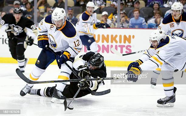 Evgeni Malkin of the Pittsburgh Penguins takes a shot on goal against Kevin Porter of the Buffalo Sabres during the game at Consol Energy Center on...