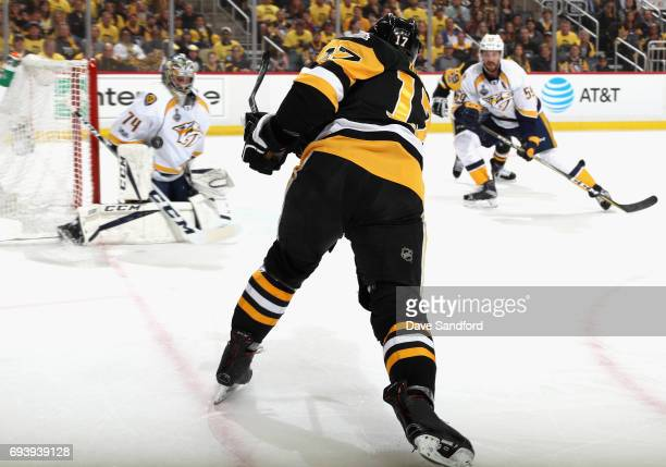 Evgeni Malkin of the Pittsburgh Penguins takes a shot on goaltender Juuse Saros of the Nashville Predators during the second period of Game Five of...