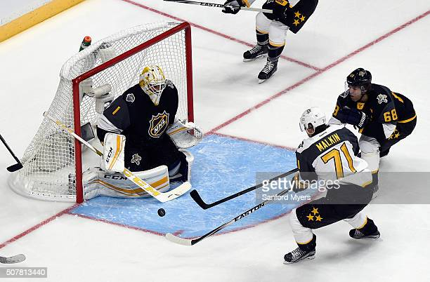 Evgeni Malkin of the Pittsburgh Penguins takes a shot on Roberto Luongo of the Florida Panthers during the Eastern Conference Semifinal Game between...