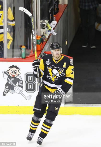 Evgeni Malkin of the Pittsburgh Penguins waves to the crowd after being announced as a star of the game at the conclusion of the Pittsburgh Penguins...