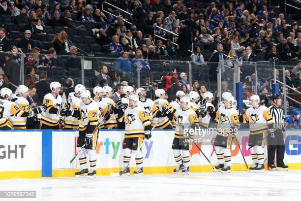 Evgeni Malkin Patric Hornqvist Dominik Simon Juuso Riikola and Olli Maatta of the Pittsburgh Penguins celebrate after scoring a goal in the third...