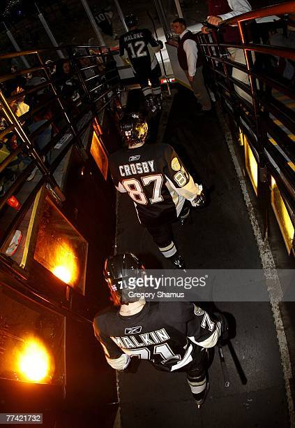 Evgeni Malkin Sidney Crosby and Ryan Malone of the Pittsburgh Penguins take to the ice prior to the game against the Carolina Hurricanes at Mellon...