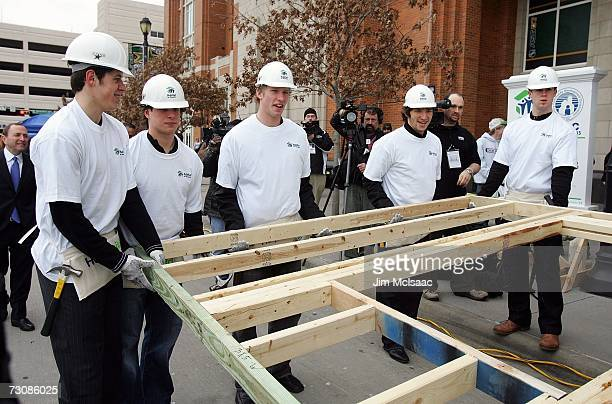 Evgeni Malkin Sidney Crosby Jordan Staal Alexander Ovechkin and Mike Green of the NHL Youngstars and AllStars help raise a wall structure during the...