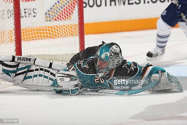 Evgeni Nabokiv of the San Jose Sharks make a big save during an NHL game vs the Toronto Maple Leafs on January 12 2008 at HP Pavilion at San Jose in...