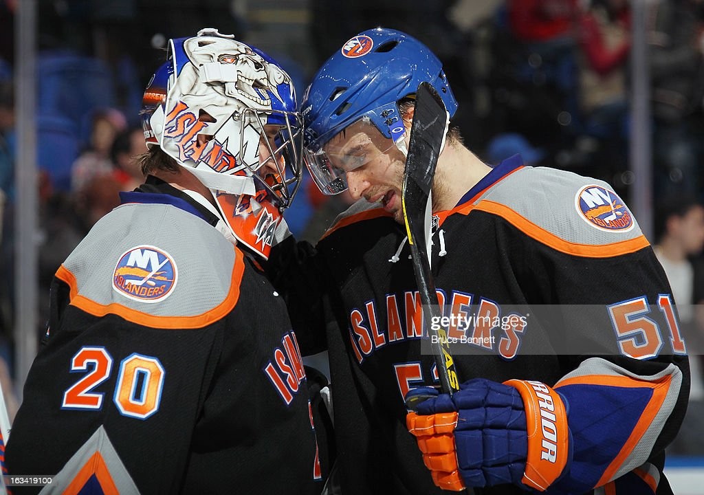 Evgeni Nabokov #20 and Frans Nielsen #51 of the New York Islanders celebrate their 5-2 victory over the Washington Capitals at the Nassau Veterans Memorial Coliseum on March 9, 2013 in Uniondale, New York.