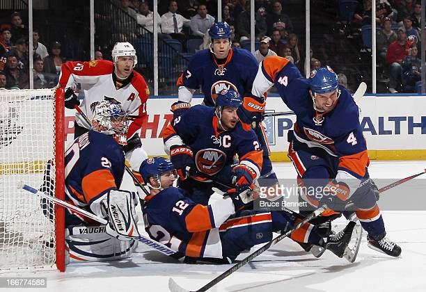 Evgeni Nabokov and the New York Islanders makes the third period goal stand against the Florida Panthers at the Nassau Veterans Memorial Coliseum on...