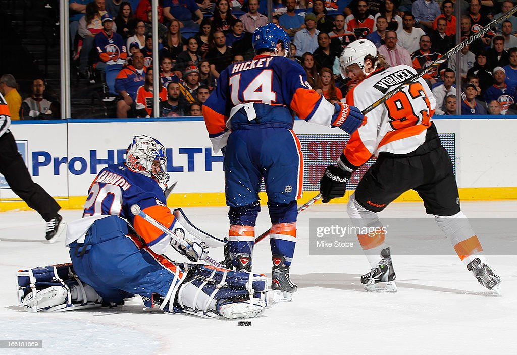 Evgeni Nabokov #20 of the New York Islanders makes a save as teammate Josh Bailey #12 and Jakub Voracek #93 of the Philadelphia Flyers look for the rebound at Nassau Veterans Memorial Coliseum on April 9, 2013 in Uniondale, New York. The Islanders defeated the Flyers 4-1.