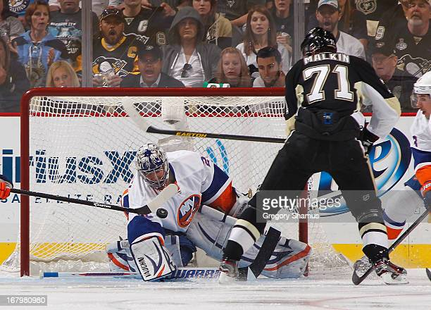 Evgeni Nabokov of the New York Islanders makes a save on a shot by Evgeni Malkin of the Pittsburgh Penguins in Game Two of the Eastern Conference...