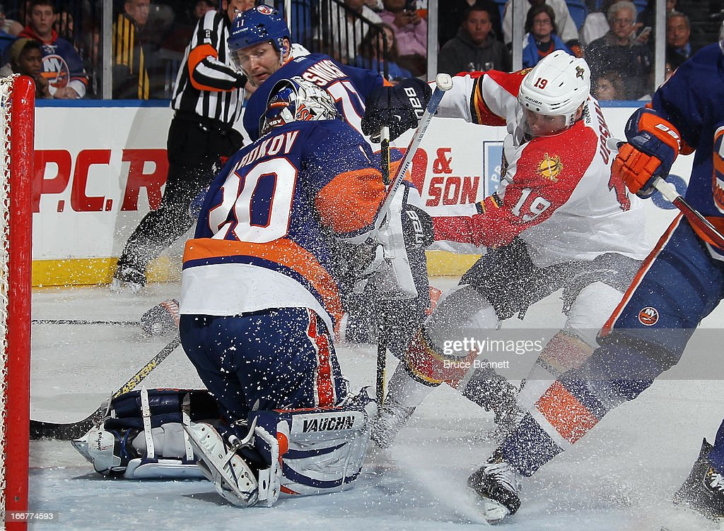 Evgeni Nabokov #20 of the New York Islanders makes the third period save on Scottie Upshall #19 of the Florida Panthers at the Nassau Veterans Memorial Coliseum on April 16, 2013 in Uniondale, New York. The Islanders defeated the Panthers 5-2.