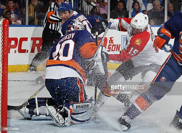 Evgeni Nabokov of the New York Islanders makes the third period save on Scottie Upshall of the Florida Panthers at the Nassau Veterans Memorial...