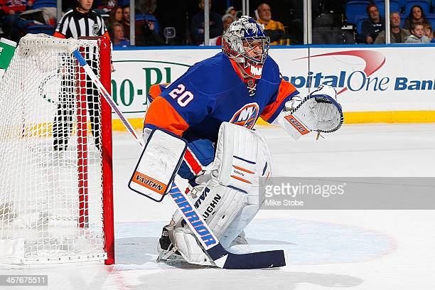 Evgeni Nabokov of the New York Islanders skates against the Montreal Canadiens at Nassau Veterans Memorial Coliseum on December 14, 2013 in...