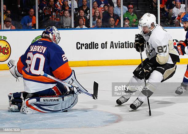 Evgeni Nabokov of the New York Islanders stops Sidney Crosby of the Pittsburgh Penguins on a breakaway in the first period in Game Six of the Eastern...