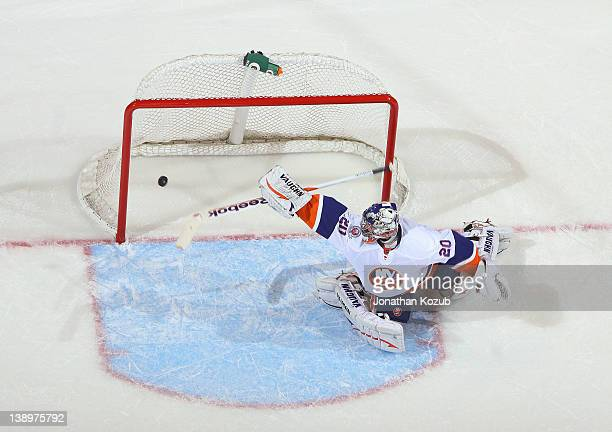 Evgeni Nabokov of the New York Islanders watches as the puck goes into the net for a first period goal by the Winnipeg Jets at the MTS Centre on...