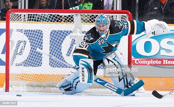 Evgeni Nabokov of the San Jose Sharks looks to snatch the puck during an NHL game against the Edmonton Oilers on February 17 2009 at HP Pavilion at...