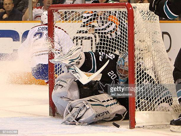 Evgeni Nabokov of the San Jose Sharks makes a save against the Montreal Canadiens during an NHL game at the HP Pavilion on March 4 2010 in San Jose...