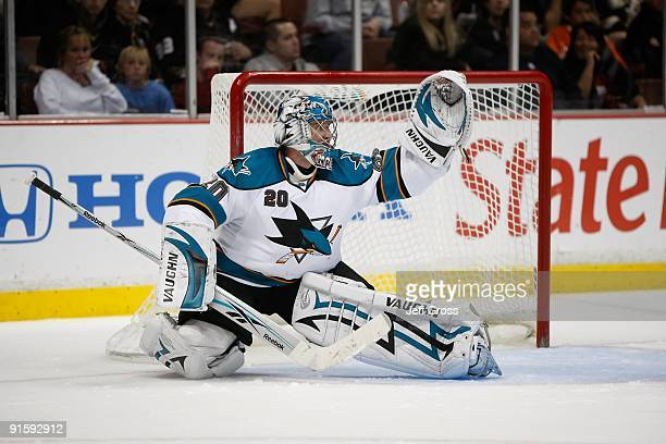 Evgeni Nabokov of the San Jose Sharks makes a save against the Anaheim Ducks at the Honda Center on October 3, 2009 in Anaheim, California. The...