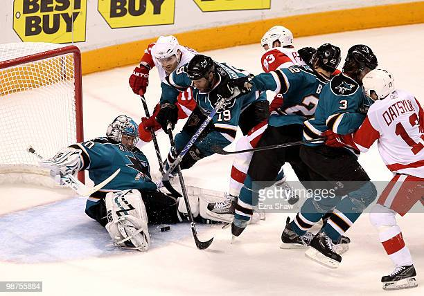 Evgeni Nabokov of the San Jose Sharks makes a save late in the third period of their game against the Detroit Red Wings in the goal in Game One of...