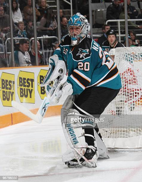 Evgeni Nabokov of the San Jose Sharks moves the puck around the net during an NHL game against the Detroit Red Wings on January 9, 2010 at HP...