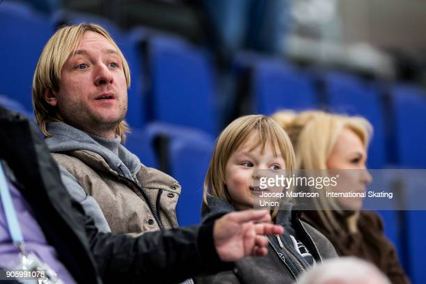 Evgeni Plushenko looks on with his son and husband in the Men's Short Program during day one of the European Figure Skating Championships at...