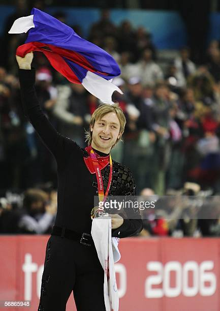 Evgeni Plushenko of Russia waves to the crowd after winning the gold medal in Men's Figure Skating following the Men's Free Skate Program Final...