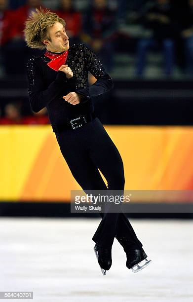 Evgeni Plushenko twirls his way to a gold medal in the men's free skating competition at the 2006 Olympics in Turin Italy Thursday