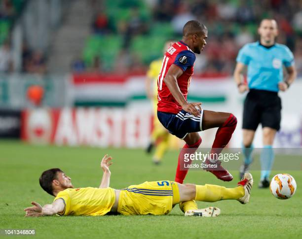 Evgeni Yablonski of FC BATE Borsiov slide tackles Loic Nego of Vidi FC during the UEFA Europa League Group Stage match between Vidi FC and FC BATE...
