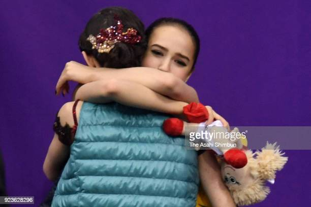 Evgenia Medvedeva and Alina Zagitova of Olympic Athlete from Russia hug after competing in the Figure Skating Ladies Single Free Skating on day...