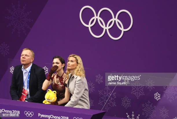 Evgenia Medvedeva of Olympic Athlete from Russia reacts after competing with coaches Sergei Dudakov and Eteri Tutberidze during the Ladies Single...