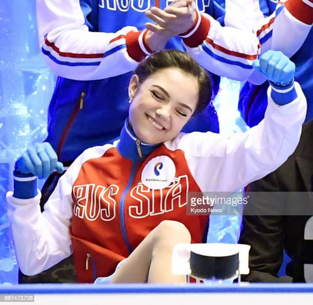 Evgenia Medvedeva of Russia pumps her fists as she scores a record 8085 points in the women's short program at the World Team Trophy figure skating...