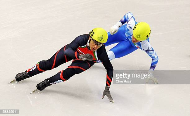 Evgenia Radanova of Bulgaria and Marta Capurso of Italy skate in the women's 500m Short Track Speed Skating Quarter Final during Day 5 of the Turin...