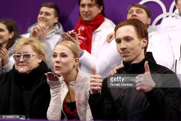 Evgenia Tarasova and Vladimir Morozov of Olympic Athlete from Russia react with teammates after competing in the Figure Skating Team Event Pair...