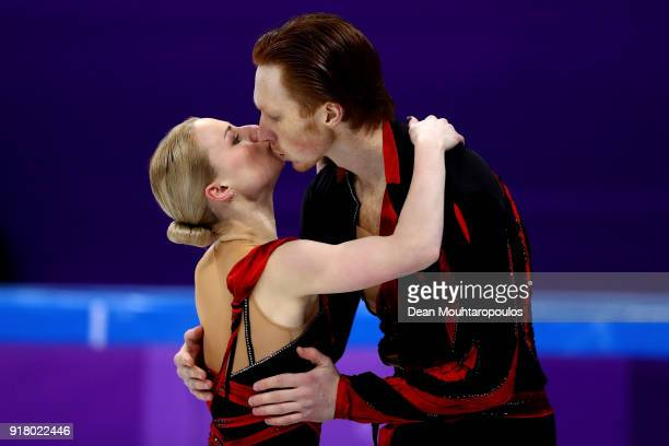 Evgenia Tarasova and Vladimir Morozov of Olympic Athlete from Russia react after their program during the Pair Skating Short Program on day five of...