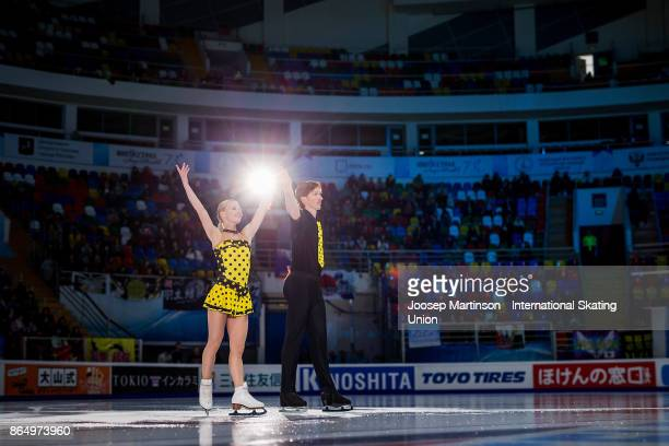 Evgenia Tarasova and Vladimir Morozov of Russia pose in the Pairs medal ceremony during day three of the ISU Grand Prix of Figure Skating Rostelecom...