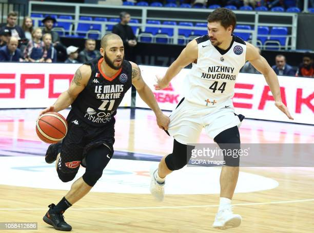 Evgenii Baburin and Michael Thomson seen in action during the game Basketball Champions League BC Nizhny Novgorod from Russia vs Le Mans from France...