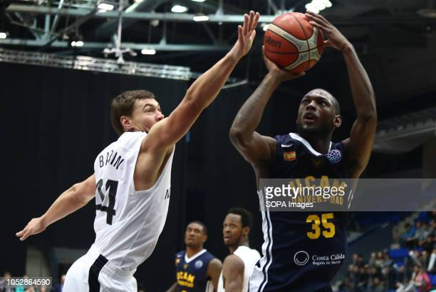 Evgenii Baburin and Miton Doyle seen in action during the game Basketball Champions League BC Nizhny Novgorod from Russia vs Ucam Murcia Club...