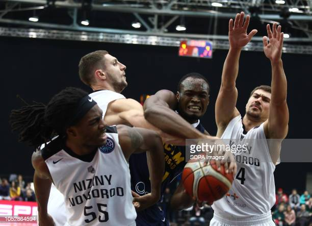 Evgenii Baburin Kendrick Perry and Askia Booker seen in action during the game Basketball Champions League BC Nizhny Novgorod from Russia vs Ucam...