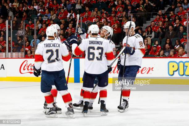 Evgenii Dadonov Aleksander Barkov and teammates of the Florida Panthers celebrate a goal against the Calgary Flames during an NHL game on February 17...