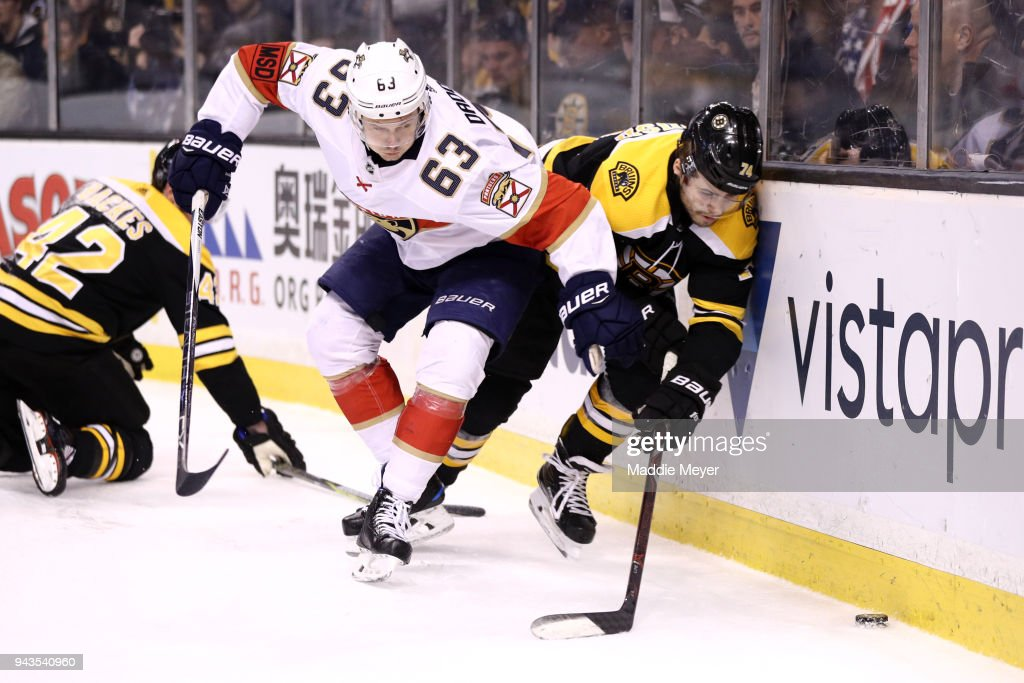 Evgenii Dadonov #63 of the Florida Panthers checks Jake DeBrusk #74 of the Boston Bruins into the boards during the third period at TD Garden on April 8, 2018 in Boston, Massachusetts. The Panthers defeat the Bruins 4-2.