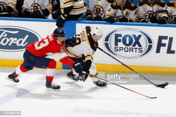Evgenii Dadonov of the Florida Panthers defends against Charlie Coyle of the Boston Bruins during third period action at the BBT Center on March 23...