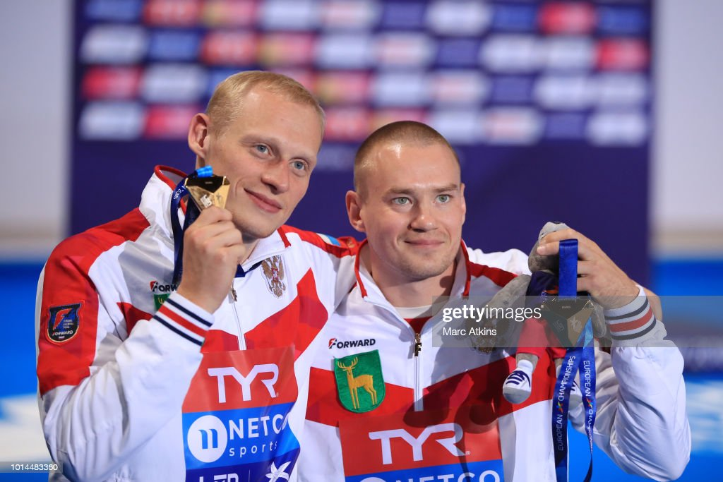 Evgenii Kuznetsov and Ilia Zakharov of Russia pose for a photo with their medals after winning the gold in Men's Synchronised 3m Springboard Final on Day Nine of the European Championships Glasgow 2018 at Royal Commonwealth Pool on August 10, 2018 in Edinburgh, Scotland. This event forms part of the first multi-sport European Championships.