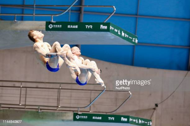 Evgenii KUZNETSOV and Nikita SHLEIKHER of Russia compete in the Men's 3 meter Synchro Springboard final during the last meeting of the FINA Diving...
