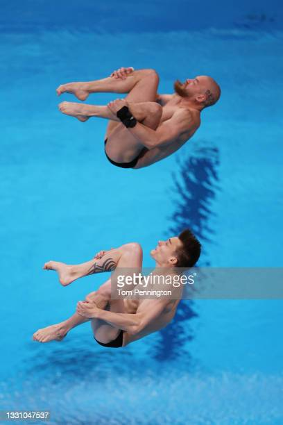 Evgenii Kuznetsov and Nikita Shleikher of Team Russian Olympic Committee compete during the Men's Synchronised 3m Springboard final on day five of...