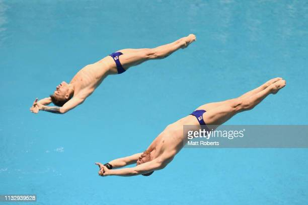 Evgenii Kuznetsov and Nikta Shleikher of Russia compete during the Men's 3m Synchro Springboard Final on day one of the FINA Diving World Cup...