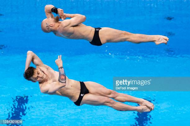 Evgenii Kuznetsov of Russian Olympic Committee Und, Nikita Shleikher of Russian Olympic Committee compete during the Men's Synchronised 3m...