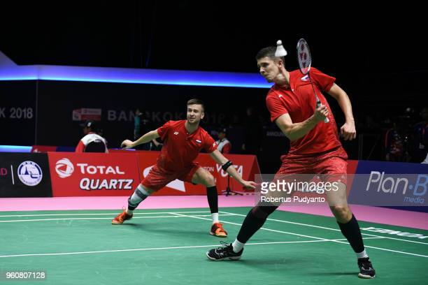 Evgenij Dremin and Denis Grachev of Russia compete against Aaron Chia and Teo Ee Yi of Malaysia during Preliminary Round on day two of the BWF Thomas...