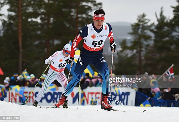 Evgeniy Belov of Russia competes during the Men's 15km CrossCountry during the FIS Nordic World Ski Championships at the Lugnet venue on February 25...