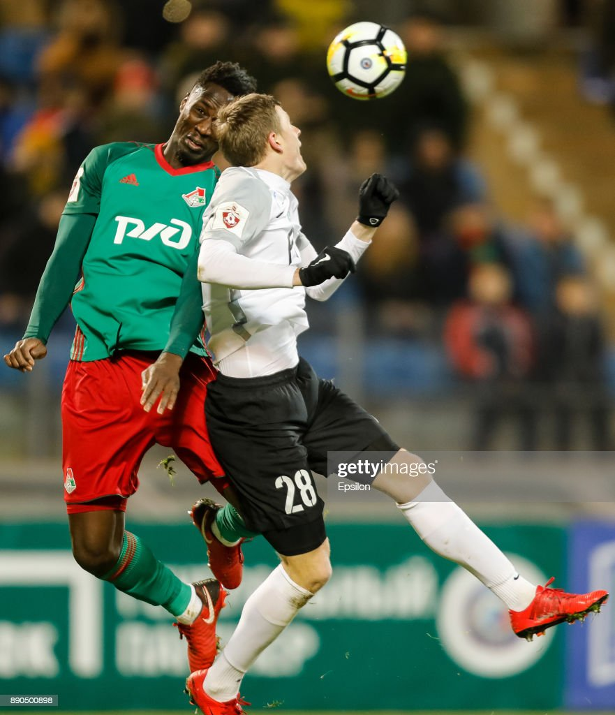 Evgeniy Chernov (R) of FC Tosno and Eder of FC Lokomotiv Moscow vie for a header during the Russian Football League match between FC Tosno and FC Lokomotiv Moscow on December 11, 2017 at Petrovsky Stadium in Saint Petersburg, Russia.