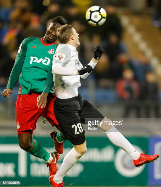 Evgeniy Chernov of FC Tosno and Eder of FC Lokomotiv Moscow vie for a header during the Russian Football League match between FC Tosno and FC...