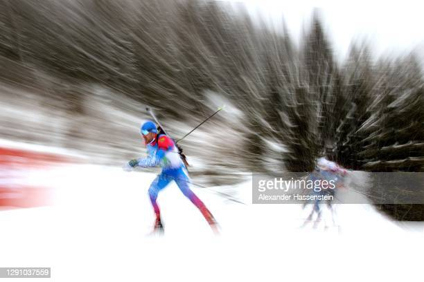 Evgeniy Garanichev of Russia leads the pack during the Men 4x7.5 km Relay Competition at the BMW IBU World Cup Biathlon Hochfilzen at at Biathlon...